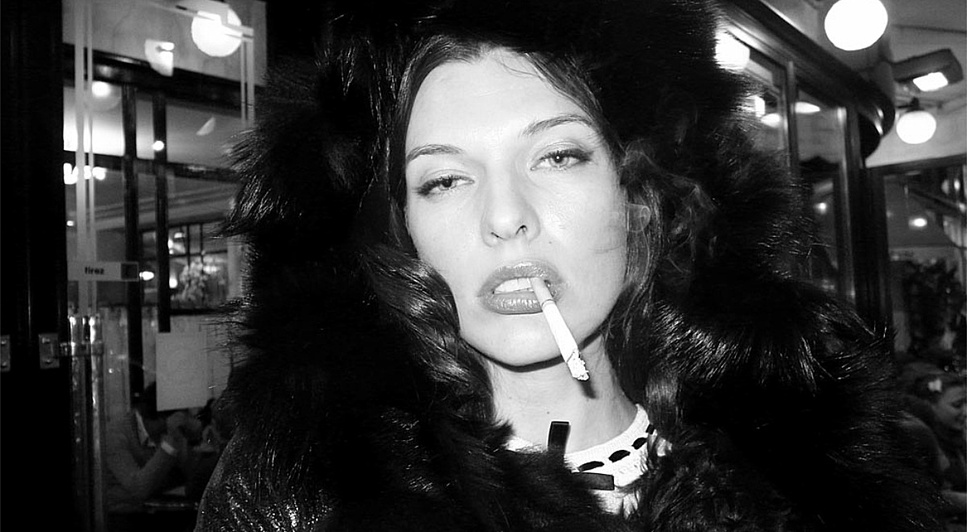 Woman. Black. White.: Milla Jovovich smoking outside the Café de Flore, Paris. Photo Olivier Zahm