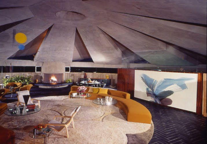 John Lautner: The living room pavilion of the Elrod Home was originally enclosed in glass, but desert storm winds blew out the glass-pane walls in 1971. Lautner said he knew the blowout was a possibility, but he decided to take the risk. After the windstorm shattered the glass, the pavilion was left as a completely open space. The owner liked the effect so much that instead of replacing the panes, he asked Lautner to open the pavilion by designing retractable glass doors. There are now two mechanized 25-foot doors fabricated by an aircraft manufacturer.