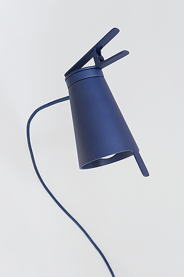 Bjørn van den Berg: Attach clip lamp is a mobile lightning spot. Out of the strict shape grows the functions for clipping and adjusting the direction of the light. The shade could be tilted and rotated in serval directions, using the lever on the edge. The clip could be attached to various surfaces.