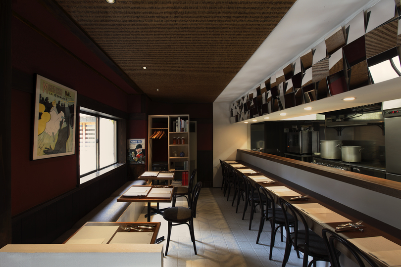 Designing a 56 sqm bistro in Tokyo: When we asked ourselves what was most important to French cuisine, we decided it was definitely the consideration and choice of compatible combinations of food, wine and cheese. Even simple items should complement each other to mutually enhance their individual flavors. This is often referred to in French as a marriage, and we wondered if we couldn't incorporate the same kind of relationship and effect into the architecture.