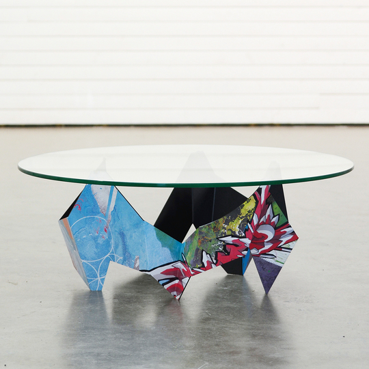 The Graffiti Table: The Graffiti Table is made from folded 3.5mm lasercut steel with a printed vinyl wraparound design.