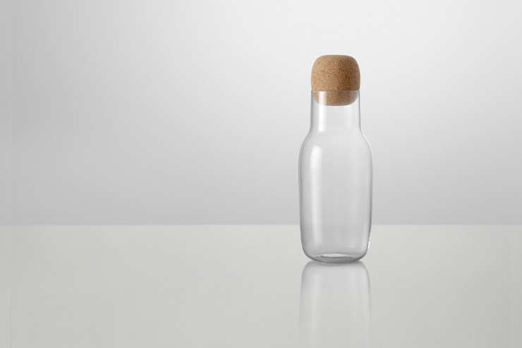 Same Same But Different: The idea behind Corky Carafe and additional drinking glasses was to work with a familiar and simple form with an oversized detail. The shape of the carafe is related to the archetype bottle - the bottle with a cork. The shape of the carafe has been given a functional character - that balances the characteristic of the ordinary. This might as well be a bottle of wine or milk bottle. The cap is large - it is easy to operate - and visible in use. The drinking glasses are meant for both wine and water - low key in their expression - for use both in everyday life and at a party.