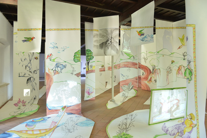 Kochi Biennale 2014: Sumakshi Singh's work titled 'In, Between the Pages' at Pepper House, Fort Kochi. Multi-media Installation: drawings, paintings and collage on paper scrolls, projection, stop-motion animation - 70 x 30 ft