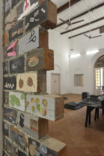 Kochi Biennale 2014: Unnikrishnan C's 'Untitled' work installed at CSI Bungalow, Fort Kochi. The artist has used oil and acrylic paint, carvings on terracotta bricks.