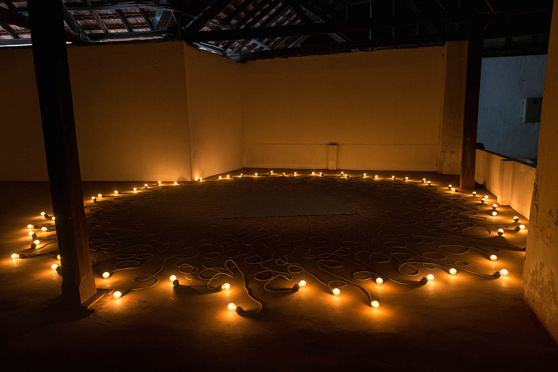 Kochi Biennale 2014: Mona Hatoum's work titled 'Undercurrent' at Aspinwall House, Fort Kochi. The artist has used Cloth covered electric cable, light bulbs, computerised dimmer unit. (31.16 ft in diameter)