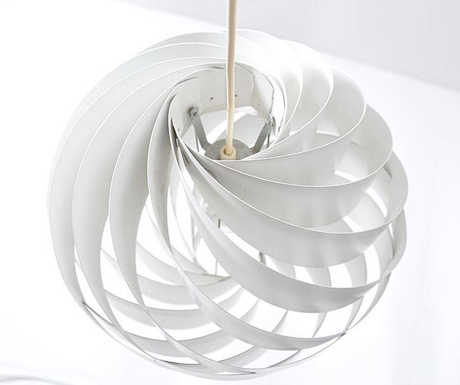 Louis Weisdorf: Multi-Lite and Turbo: Louis Weisdorf created the design for his Turbo pendant light in 1965, and in 1967 Lyfa was ready to start production. Consisting of 12 uniform aluminium lamellae spiral-twisted to form a flower-like sphere, the Turbo was partly inspired by Japanese rice-paper lanterns, and came in two sizes – the 35cm diameter Turbo I (available in orange, red, beige or white) and the 60cm Turbo II (in white only).   The Turbo was winning an iF (Die gute Industrieform) product design award in 1973, and remained in production well into the 1970s.   In 1991  a new version of the Turbo was put into production by Lyskjær-Lyfa, without the knowledge or approval of Louis Weisdorf. Renamed Regina and made of steel, the lamp was so heavy it had to be suspended by a wire. Weisdorf took the company to court and sales were halted.  In 2004 the Turbo was reissued again in white versions.