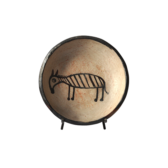 Serve Up!: Donkey pattern plate. Handmade Terra cotta, natural color, pattern painted with vegetal color, Tribal collection. H8 x L34 x P34 cm.  Designer : Zeineb & Salah Sfar Stand name : TINJA. Show : MAISON&OBJET Copyright : Yasmine Sfar