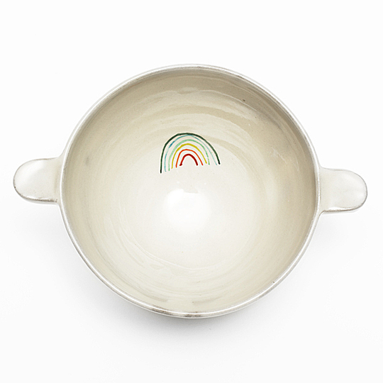 Serve Up!: Two-handle bowl. Emblematic item of our childhood, the two-handle bowl evokes a delicious hot chocolate. Francine Triboulet revisits this traditional classic and revives it with a rainbow decoration. A mouth-watering collection for everyone to enjoy. Designer : Francine Triboulet. Stand name : FRANCINE TRIBOULET. Show : MAISON&OBJET Copyright : Anthony Girardi